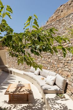 Sinas Architects designs Xerolithi vacation house with curving stone walls