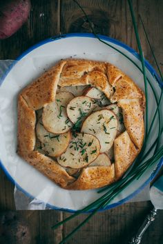 salt & vinegar potato galette with caramelized onions and parmesan