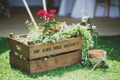 Personalised Crate with potted plants - Image by Lola Rose Photography - A wedding gown by Enzoani for an English back garden DIY wedding in Surrey. With hand picked flowers and Bridesmaids dresses from French Connection and Alfred Sung. The Groom wears a classic morning suit.