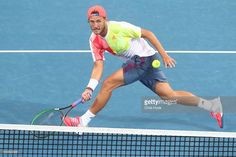 Lucas Pouille of France plays a forehand during his match against Gilles Simon of France on day three of the 2017 Brisbane International at Pat Rafter Arena on January 3, 2017 in Brisbane, Australia.