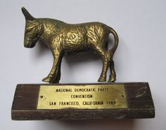 National democratic party conventionsan francisco, california 1984brass donkey on wooden base4 1/4 tall from bottom of wooden base to top of earswooden base is approx 4 3/4 in length x 3 1/4 wide donkey and base are still solid and sturdy, but does show cosmetic surface age wear. Brass donkey shows wear and oxidation. Wood base shows scrapes and scratches. Generalized surface soiling to both.ships out within one business daythanks for viewing this listing!international buyers –...