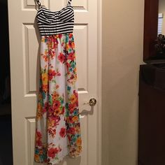 Gorgeous and unique striped a and floral dress. Gorgeous and unique striped and floral dress. Padded top with adjustable straps.  Back has a tie and small back opening.  Very flattering on. 2b bebe Dresses Maxi