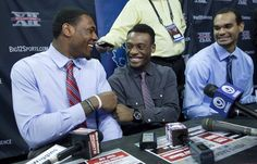 Kansas University senior Tarik Black, junior Naadir Tharpe, and sophomore Perry Ellis jolly during Big 12 Men's Basketball Media Day on Tuesday, Oct. 22, 2013, at Sprint Center in Kansas City, Mo. #KU