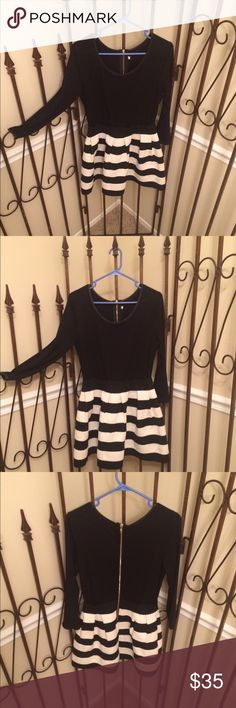 DRESS Stretch bodice in black and cute wide skirt portion black n white too cute this dress screams cute classy small trim is faux leather dress is 20 sleeve bust to bust 16.5 and 32 from shoulder to knee BOUTIQUE QUALITY zipper back 💥🌟💥🌟💥 boutique Dresses