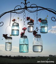 Hanging Mason Jars are the best! I want a ton of them in my back yard... when I get a back yard...with grass