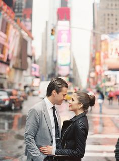 Times Square: http://www.stylemepretty.com/new-york-weddings/new-york-city/2015/06/12/8-charming-engagement-session-spots-in-new-york-city/