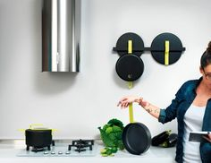 """Pots And Pans That Looks Like Wall Art: """"Hook is a new collection from neon-loving Karim Rashid that positions pots and pans as part of the decor--a kind of coming-out-of-the-cupboard celebration for the hardworking tools of the trade. The series is a collaboration with Italian brand TVS, a specialist on the cutting edge of nonstick cookware since the 1960s."""" (thanks, fastcodesign.com)"""
