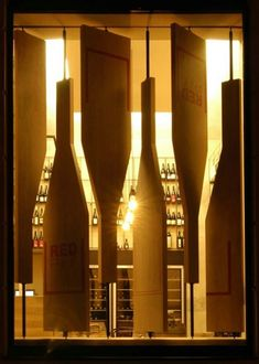 Red Pif Restaurant and wine shop, Prague.  Wine bottle shaped, rotating shutters.