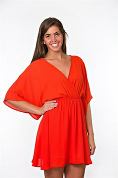 Our Tomato Toss Dress is picnic ready! A short dress with a V-neck and wide sleeves. Adorable wedges will pair perfectly!