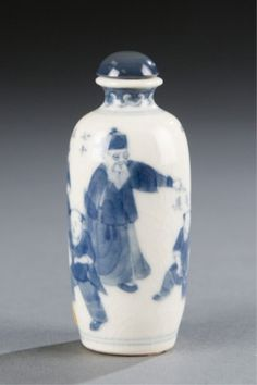 Lot 502: A Chinese soft paste porcelain snuff bottle with scene of 2 adults and 4 boys in blue under glaze decoration.. c.1800-1880. Estimate: $400-$600.