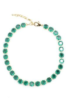 """Look like a million bucks without breaking the bank. This emerald crystal necklace will have you looking like royalty! This necklace can be dressed up for formal occasions, styled preppy or more trendy by layering necklaces!  Necklace is approximately 16"""" long."""