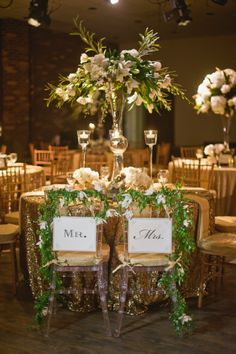 Decorative reception chairs and stunning sweetheart table floral arrangement |  Lissa Anglin Photography | flowers: Parie Designs | www.theknot.com