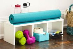 Small-Space Home Gym Hacks for Your Tiny Apartment Use storage bins or a cabinet with multiple nooks to keep all your fitness gear organized.Use storage bins or a cabinet with multiple nooks to keep all your fitness gear organized. Home Gym Set, Small Home Gyms, Best Home Gym, Home Gym Decor, Small Homes, Gym Room, Gym Design, Storage Bins, Closet Storage