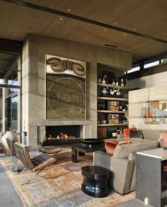 Stunning persian carpet, fireplace and the modern classic Barcelona Chair.  Love this room