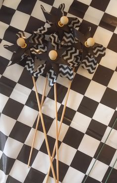 Black & White Chevron Plastic Pinwheels from Hobby Lobby - I used them in centerpieces.