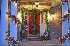 Porch Decorated for Christmas with Garland...great tutorial for making a PB knockoff garland!! LOVE the three wreaths too...the WHOLE porch....