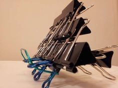 I-Pad stand - from 54 Uses For Binder Clips That Will Change Your Life - someone has too much time on their hand at their office job. Just saying.
