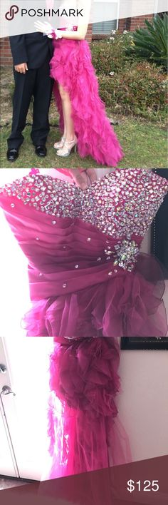 Mori Lee Gown A beautiful strapless Mori Lee gown, size 3/4. Only worn once. Hot pink in color, has a corset tie, crystal detailed, high low style with ruffling. Would be perfect for prom, homecoming, or ball! Mori Lee Dresses Prom