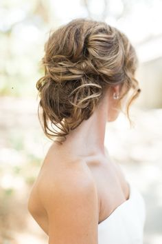 Gorgeous tousled bridal updo: http://www.stylemepretty.com/california-weddings/carmel/2016/03/19/rustic-carmel-valley-ranch-wedding/ | Photography: Carlie Statsky - http://www.carliestatsky.com/