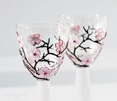 Hand painted wine glasses with cherry blossoms and Swarovski crystals.  So pretty.
