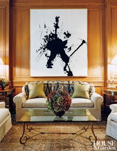 In the living room of a Manhattan home designed by David Kleinberg, Hans Hofmann's dynamic Don Quijote tilts against a plush sofa. The gilded-iron cocktail table, topped with glass, is from Jean-François Dubois.  ARCHITECT: Nasser Nakib Architect DESIGNER: David Kleinberg Design Associates PHOTOGRAPHER: Thomas Loof