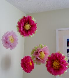 These are different, not the standard tissue pom. could be hung from the ceiling throughout the room>> Tissue Paper Pom Pom/ Flower Perfect by especiallyforyoubyyw