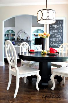 #LimitlessDesign #Contest Cool chandelier.  I also like the contrast of white and black for the table.  All black would be too much, and all white would contrast to much from the cabinets. The style would need to be reworked to fit with the counter chairs.