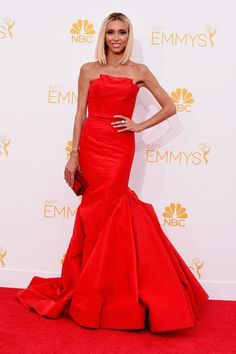 """It's no surprise that """"Fashion Police"""" host Giuliana Rancic looked absolutely stunning on the red carpet. The television personality showed off her fit figure in a strapless red Gustavo Cadile gown."""