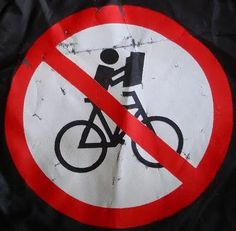 Please refrain from reading newspapers while cycling - sign in Copehagen