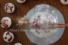 """Dexter themed party cake. Barbie, Saran Wrap, strawberry """"blood""""  {Nina's Cake and Bake Shoppe} on Facebook and Instagram!!"""
