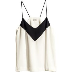 Product V-neck top in a crêpe weave with thin shoulder straps in imitation leather, a racer back, and a rounded hem that is slightly longer at the back. 100% v…