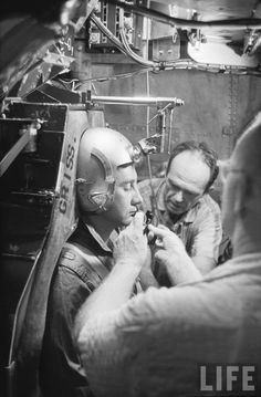 "American astronaut Virgil ""Gus"" Grissom undergoing centrifuge exam to simulate high G forces encountered during space flight, part of many medical tests and training prior to the Mercury mission. Location: Huntsville, AL, US Date taken: August 1959 Photographer: Ralph Morse"