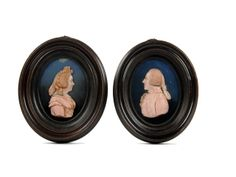 A pair of early 19th Century pink wax relief bust portraits of a lady and gentlemanIn the manner of Pieter Rouw the Younger, (1771-1852) Sol...