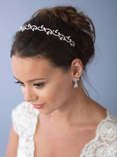 FLORAL GARDEN HEADBANDThe bridal headband features a scrolling floral pattern comprised of round and marquise rhinestones that glimmer effortlessly. Floral Headband Wedding, Floral Headpiece, Floral Headbands, Headpiece Wedding, Bridal Headpieces, Floral Wedding, Bridal Hair, Bride Hair Accessories, Wedding Hair Pieces