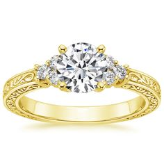 18K+Yellow+Gold+Adorned+Trio+Diamond+Ring+from+Brilliant+Earth OH I LOVE THIS!