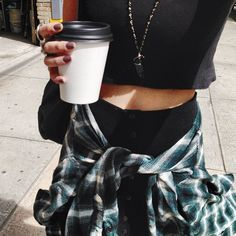 Loving the check shirt tied round the waist and the causal Starbucks