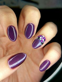 Purple gel shellac nails almond shape with diamanté design