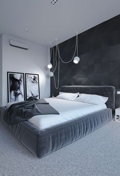 Imagine sleeping in this minimalist black, white, & gray bedroom. The bed looks super cozy w/ its white sheets & soft headboard. What a relaxing room!