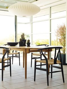 Bring the outdoors, in. Wishbone Chair | Designed by Hans J. Wegner