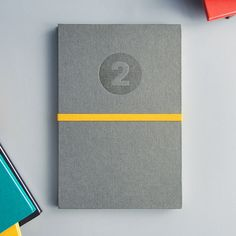 Handmade Grey Notebook with Yellow Band - Letterpressed printed. €25.00, via Etsy.