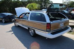 Buick Roadmaster wagon. 5.7 liter iron-block GM V-8 (*not* Corvette spec). As seen at the September 2015 Cars and Coffee show in Austin TX USA.