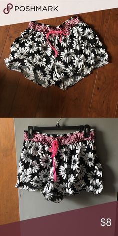 Flowy sunflower shorts Black and white with pink details at top. Wore once. One of the tie strings is coming unbraided. Size is little girl 18, but fit a size 8 women. Justice Shorts