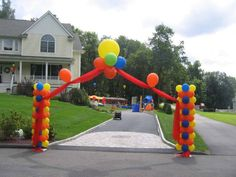 Carnival entrance made with balloons and toile.  The toile fabric is being held up by the helium balloons making this easy to do,