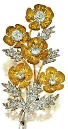 Cartier ,CIRCA 1900, Diamond brooch.designed as a Floral spray ,petals're Gold.