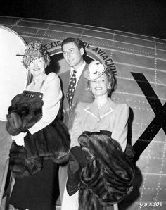 """Hedda Hopper, Errol Flynn and Faye Emerson catch an airplane for Mexico City, where they are to take part in a Red Cross drive and the premiere of """"Yankee Doodle Dandy"""" in 1942"""