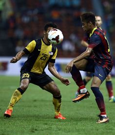 Neymar of Barcelona FC tackles Wan Zack of Malaysia during the friendly match between FC Barcelona and Malaysia at Shah Alam Stadium on August 10, 2013 in Kuala Lumpur, Malaysia.