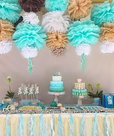 use curling ribbon to tie pompoms then curl once done...on the wall by the food we use the same puffs to tie it all together