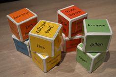 taak hoekenwerk: zinnen en woorden. Doel: Zinnen maken met de zinsdelen op de dobbelstenen.
