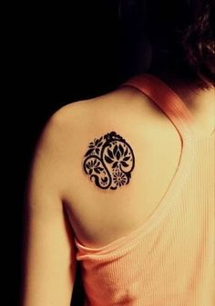 alter the design to use the om symbol to create the encompassing effect. shoulder placement.