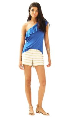 """The Adie Short is a 4"""" short with a metallic stripe. These shorts have it all: scallop side seam hem, button in the front, and pockets. Pair these with gold sandals during the day and and gold wedges at night to complete the look."""